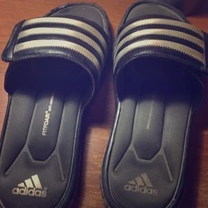 Adidas og cushioned slides used. Velcro straps.